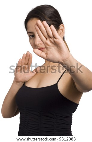 A young woman is doing tai chi moves over white background - stock photo