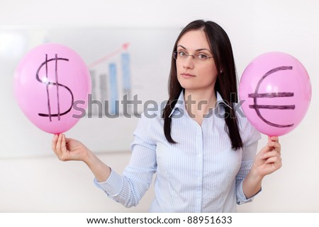 A young woman is holding two balloons marked with the dollar and euro symbols with an ascending chart in the background.