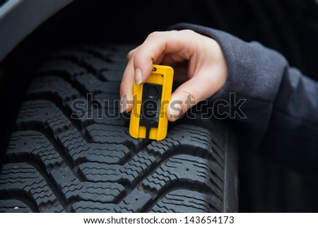a young woman is measuring the...