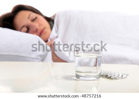 A young woman is sleeping in the bed. All on white background.