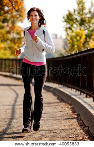 A young woman jogging on a path in a park