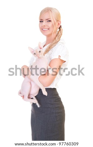 a young woman laughing. She holds a rare breed of cat, the Sphinx, in her hands