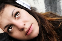 A young woman listening to melancholic Music