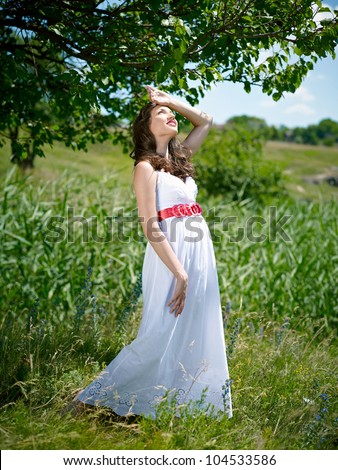 A young woman on a background of the nature