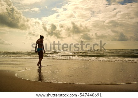 A young woman on a beach in Netherlands