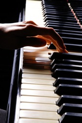 A  young woman playing piano closeup