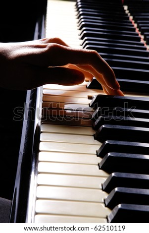 A young woman playing piano closeup