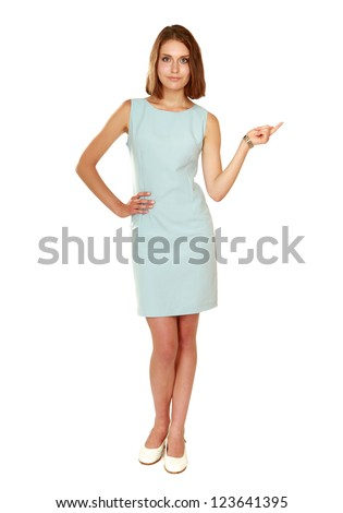 A young woman  pointing at something, isolated on white