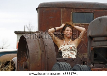 A Young Woman Posing in the Bed of an Antique Truck