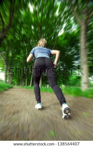 A young woman quickly runs into the forest