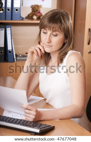 a young  woman reading some bad news