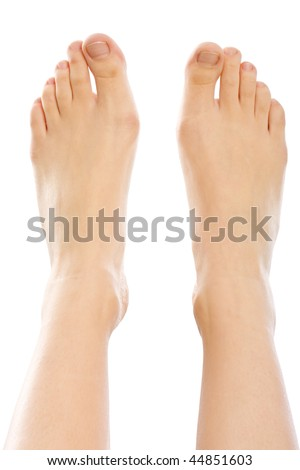 A young woman 's feet closeup, isolated on white.