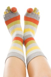 A young woman 's feet wearing closeup, isolated on white.