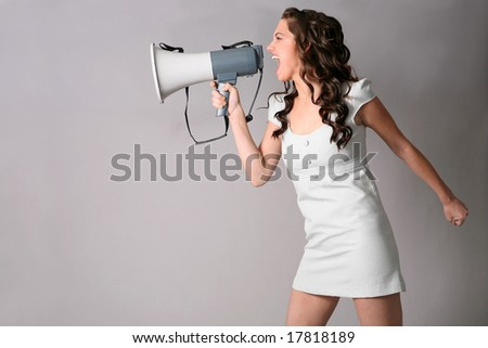 a young woman shouting into a megaphone