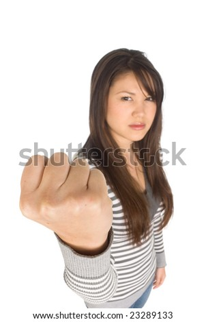 A young woman shows a fist of rage.