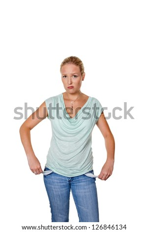 a young woman shows empty pockets of her jeans. symbolic photo for debt.