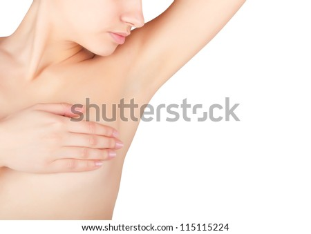 A young woman shows her clean armpit isolated on white background