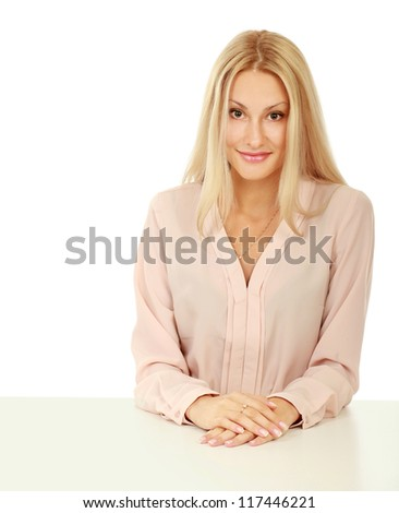 A young woman sitting at the desk, isolated on white background
