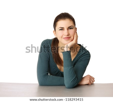 A young woman sitting isolated on white background