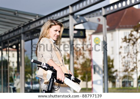 A young woman travelling on public transport with bike