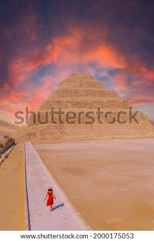 A young woman visiting the Stepped Pyramid of Djoser, Saqqara. Egypt. The most important necropolis in Memphis. The first pyramid in the world Stock photo ©