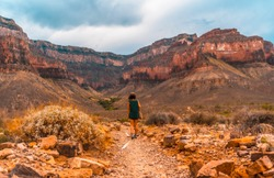 A young woman walking along the Bright Angel Trailhead at the Tonto West turnoff, in the Grand Canyon. Arizona