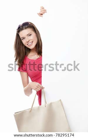 A young woman with a bag and billboards