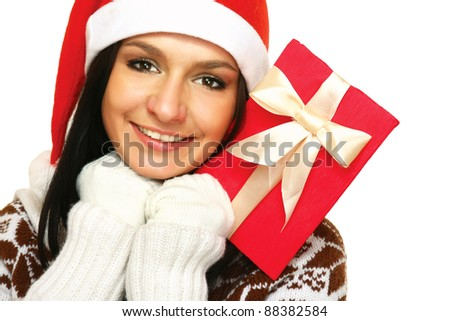A young woman with a Christmas present looking up, isolated on white