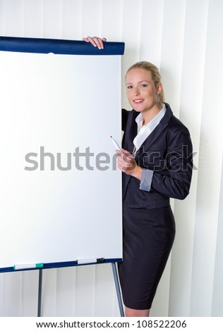 a young woman with a flip-chart board during a presentation. training and adult education.