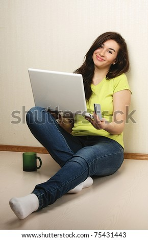 A young woman with a laptop and a card