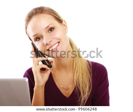 A young woman with a laptop talking on the phone isolated on white background