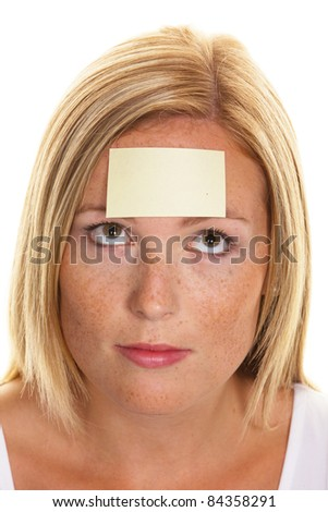 A young woman with a notepad on forehead