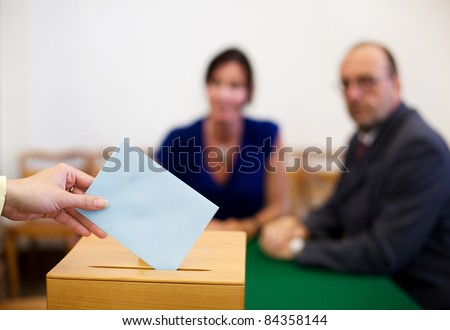 A young woman with a voter in the voting booth. Voting in a democracy