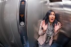 a young woman with claustrophobia in an elevator