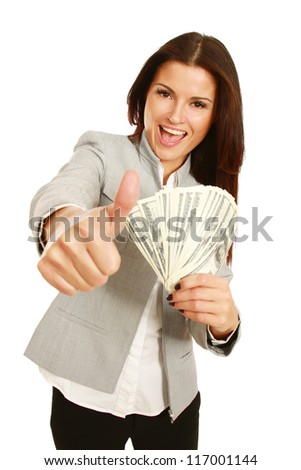 A young woman with dollars in her hands and showin g ok, isolated on white background