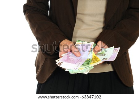 A young woman with Euro banknotes in her hand