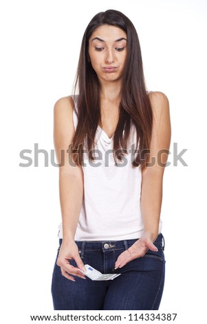 A young woman with euro in hand, isolated on white background