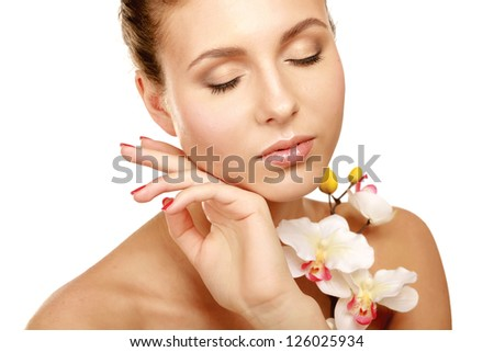 A young woman with orchid, isolated on white