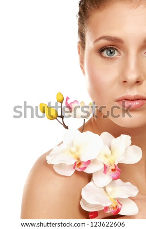 A young woman with orchid, isolated on white background