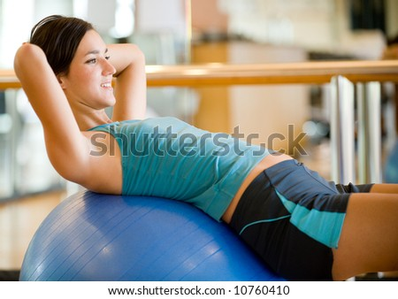 A young woman working out in a gym