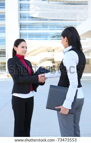 A  young women business team at the office handshake