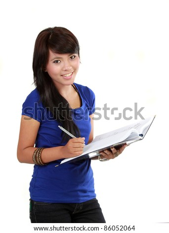 a young women writing in a notebook isolated on a white background.
