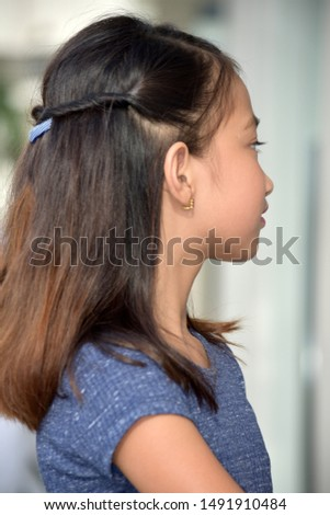 A Youthful Female With Long Hair