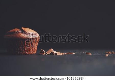 Stock Photo A yummy Chocolate cupcake and chocolate shavings