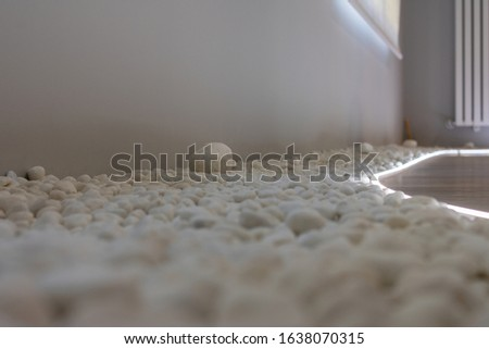 a zen floor decorated with small white stones