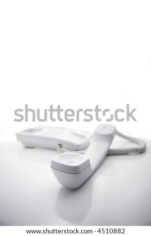 A ''zen'' type series featuring a white telephone on white background.