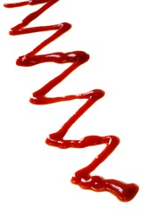 A zig-zag of bright red ketchup, isolated on white.