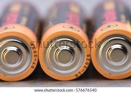 AA Batteries Closeup on Metal Background #576676540