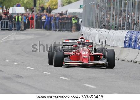 AARHUS, DENMARK - MAY 23 2015: Claus Bertelsen in a Ferrari Jean Alesi formula one racing car from 1992 at the Classic Race Aarhus 2015