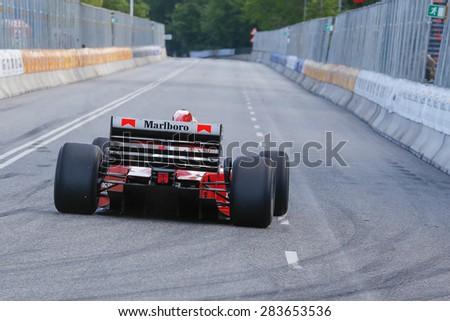 AARHUS, DENMARK - MAY 22 2015: Claus Bertelsen in a Ferrari Jean Alesi formula one racing car from 1992 at the Classic Race Aarhus 2015